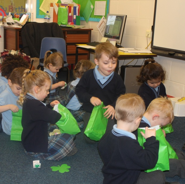 St Patrick's Day Children investigating their goody bags