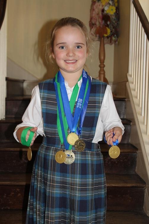 caitlin-swiming-medals