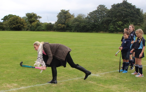 miss-hopwood-helps-with-warm-up
